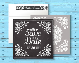 Wedding invitation vintage card with floral. Wooden background
