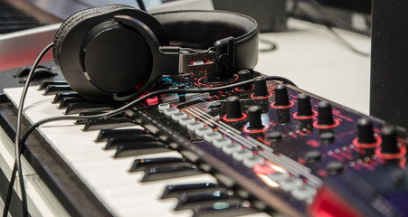 headphones lying on the synthesizer