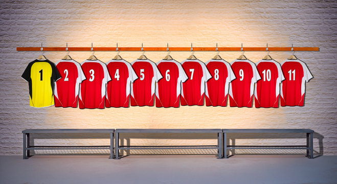 Row of Red and Yellow Football Shirts hanging on Wall in Changing Room with Bench