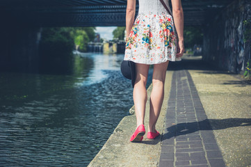 Young woman walking by canal