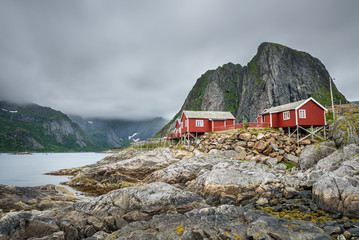 Wall Mural - Traditional red rorbu cottages  in Hamnoy village, Lofoten islands, Norway