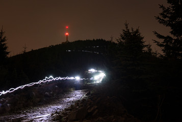 extreme trail running in the night with head lamps with light track