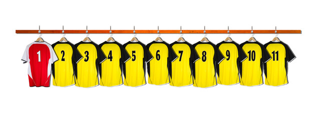 Row of Yellow and red Football Shirts hanging on wall