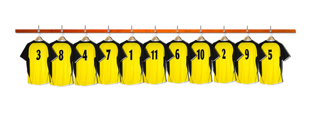 Row of Yellow Football Shirts hanging on wall