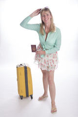 Woman holidaymaker with passport and suitcase
