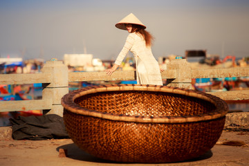 view of Vietnam fishing basket against blonde girl in national