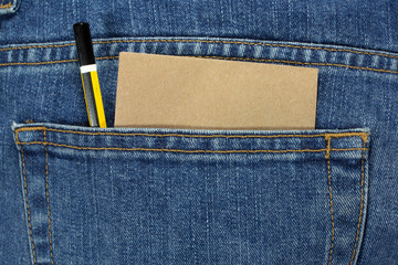 pencil and note paper in a blue jean pocket