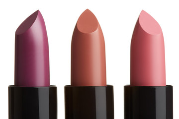 Lipstick group in purple, brown, pink colors on white, clipping path
