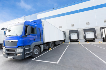 Blue Truck and Gates of Big distribution warehouse
