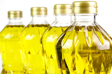 three bottles oil of refined palm olein from pericarp
