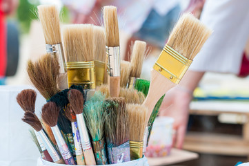 Many brushes Of different sizes and shapes in soft light, blur