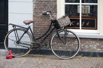 Old traditional bike parked in front of the café