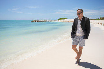Businessman walking on the beach