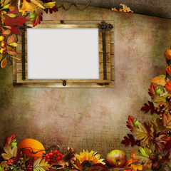 Autumn leaves, berries and frame on a green vintage background