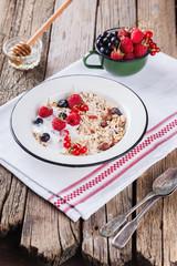 Granola, muesli , honey, yogurt and fresh berries .Healthy breakfast.selective focus