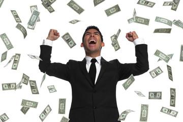 Raining money on a celebrating businessman