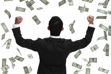 Behind veiw celebrating businessman in money