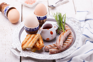 Breakfast, eggs, Soseki grill and toast on a tray. selective focus
