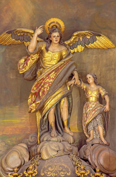 CORDOBA, SPAIN - MAY 27, 2015: The carved polychrome statue of archangel Raphael (Santo Angel) patron of the Town from 18. cent. on the altar in church Convento de Capuchinos (Iglesia Santo Anchel).