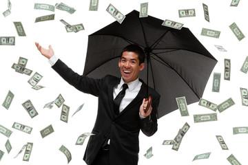 Business man with umbrella in money rain storm