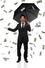 Excited businessman with raining money