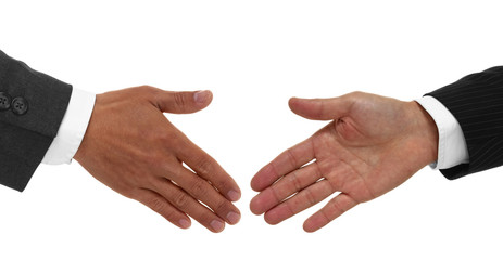 Two hands shaking in agreement isolated on white