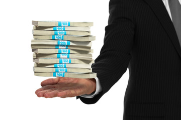 Close up of businessman hand with stacks of money floating above