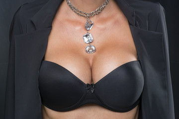 Woman with Big Breasts and jewelry on neck