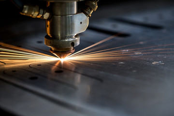 Cutting of metal. Sparks fly from laser Wall mural