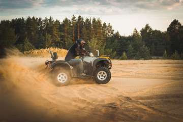Racing ATV is sand.