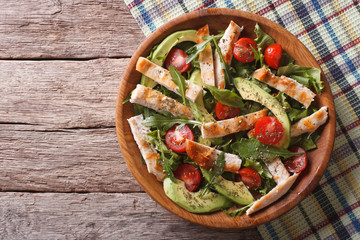 Chicken salad with avocado, arugula and tomatoes. horizontal top view