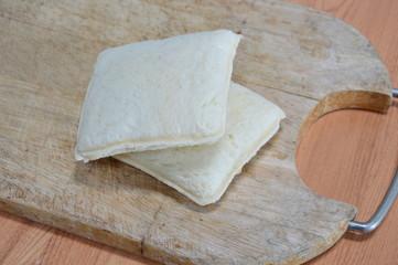 tuna sandwich cut on chop block