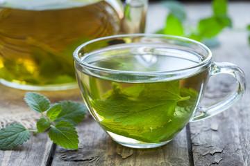 Fresh natural green melissa herbal tea in glass cup. Organic