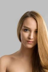 Gorgeous brunette woman posing on gray
