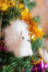 Squirrel Christmas toy on a tree