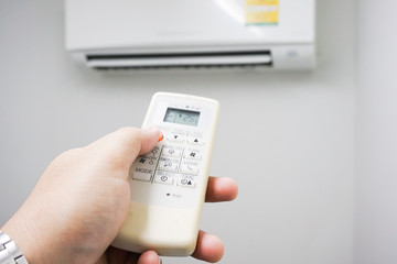 adjust air conditioner to 25 degrees celsius with remote control