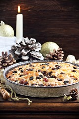 Christmas cake with caramelized nuts,raisins and spices. Selective focus