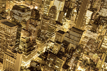 Wall Mural - Golden cityscape of New York City buildings and lights at night