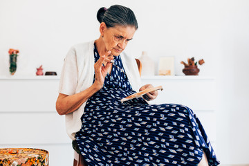 89 year old woman sits and sews without glasses