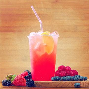 Berry lemonade in plastic cup