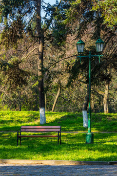 old city park with bench and lantern