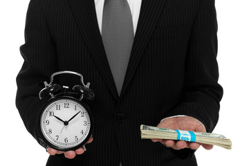 Close up of businessman holding a clock and one stack of cash in