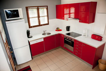 Modern red kitchen, in a house