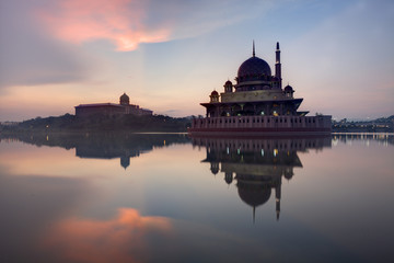 Malaysia, Putrajaya, Putra Mosque and JPM during reflective sunrise