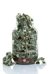 Money jar full wtih money spilling out
