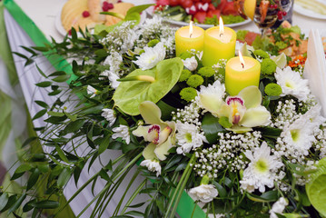 Bouquet of wedding flowers, decorated with candles