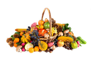 Autumn harvest - fresh autumn fruits and vegetables in wicker basket on white background