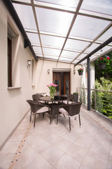 Covered terrace with garden furniture