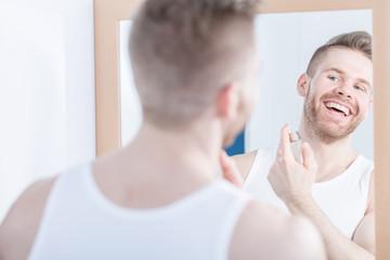 Smiling man admiring his reflection