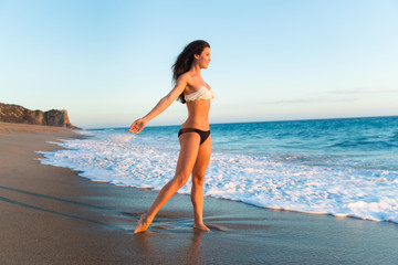 Beauty in nature at the beach bikini freedom vacation travel young single thin woman